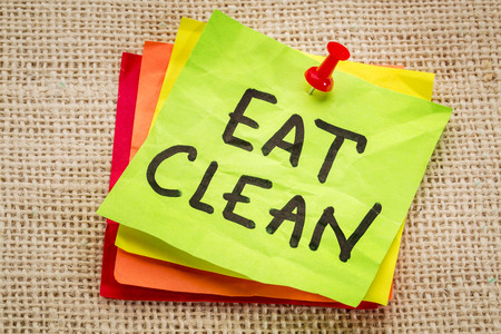 eat clean reminder on sticky note - healthy eating concept