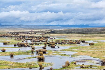 illinois river: Illinois River meanders through Arapaho National Wildlife Refuge, North Park near Walden, Colorado, spring scenery with flooded meadows Stock Photo