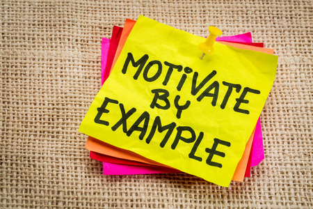 role model: motivate by example - advice or reminder on a yellow sticky note