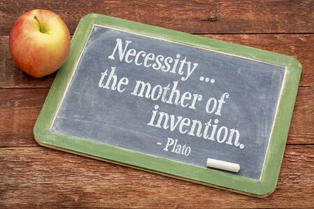necessity: Necessity - the mother of invention  - Plato quote  on a slate blackboard against red barn wood Stock Photo