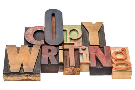 copywriting: copywriting word  - isolated text in mixed letterpress wood type printing blocks