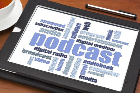 podcast: podcast word cloud on a digital tablet with a cup of coffee - internet radio concept Stock Photo