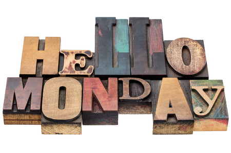 wood type: Hello Monday typography abstract - isolated text in mixed letterpress wood type blocks