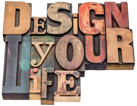 printing block block: design your life - motivational advice - isolated word abstract in mixed vintage letterpress printing blocks