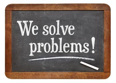 solve problems: We solve problems  - text on a vintage slate blackboard - service marketing concept Stock Photo
