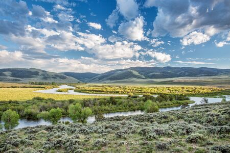 meanders: meanders of North Platte River above Northgate Canyon, North Park, Colorado - early summer scenery with partially cloudy sky