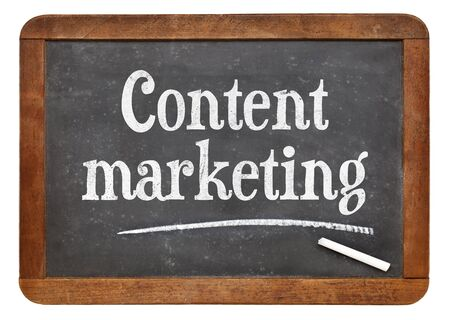 Content marketing sign - text on an isolated vintage slate blackboard