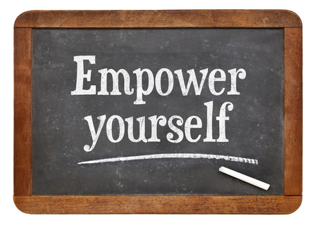 self development: Empower yourself motivational phrase - text on an isolated  vintage slate blackboard