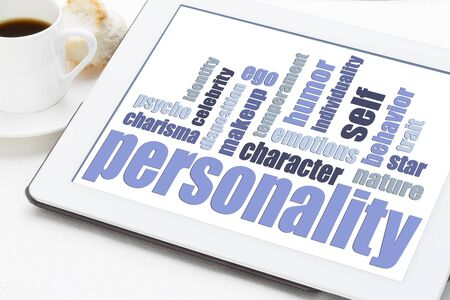 personalities: personality word cloud on a digital tablet with cup of coffee