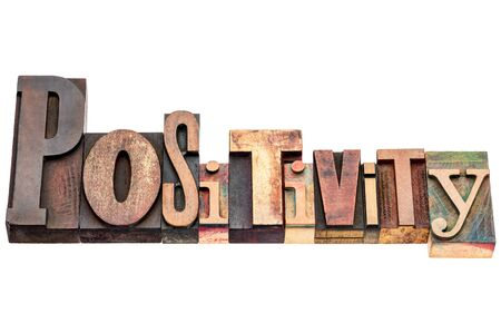 positivity: positivity word typography - isolated text in mixed vintage letterpress wood type printing blocks Stock Photo
