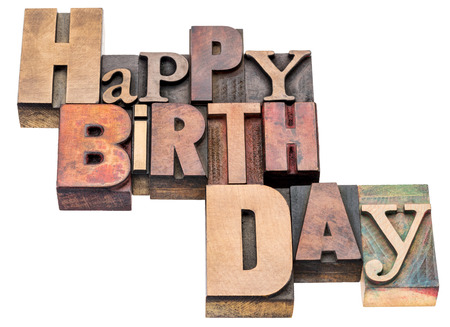 Happy Birthday sign or greeting card - isolated text in vintage mixed letterpress wood type Stock Photo