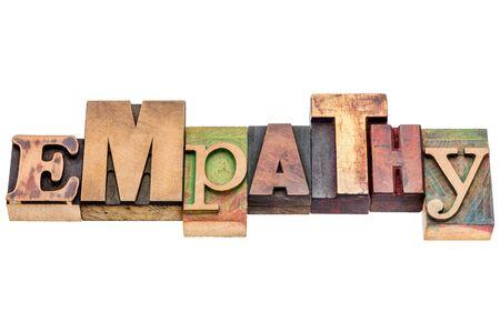 empatia: Resumen de palabras de empatía - texto aislado en bloques de tipo madera de tipografía Foto de archivo