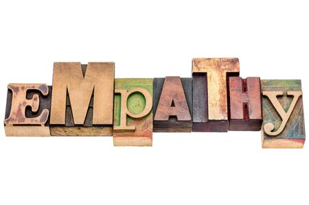 empatia: Resumen de palabras de empat�a - texto aislado en bloques de tipo madera de tipograf�a Foto de archivo