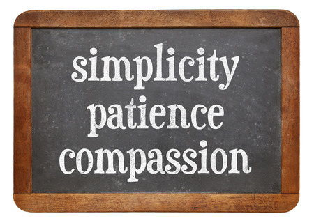 Simplicity, patience and compassion - three words from Buddha teaching on a vintage slate blackboard Фото со стока