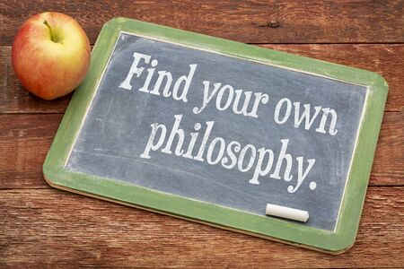 philosophy: Find your own philosophy - motivational words on a slate blackboard against red barn wood