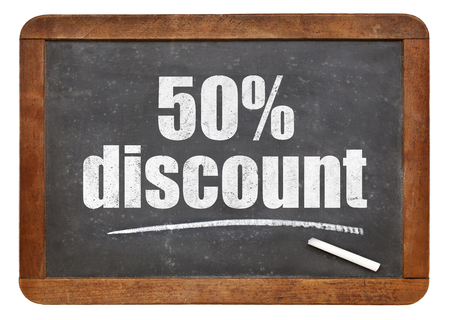 white chalk: fifty percent discount sign - white chalk text on an isolated  vintage slate blackboard Stock Photo