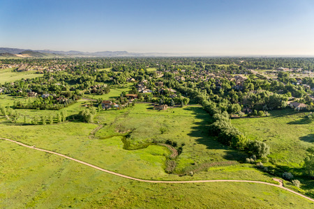 bike trail: aerial view of foothills prairie in Colorado with a bike trail and residential area