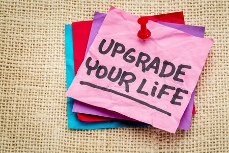 self development: upgrade your life advice - motivational text on a sticky note