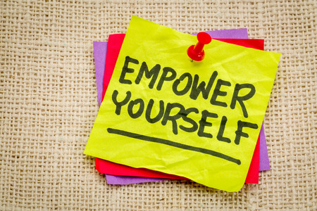 empower: empower yourself reminder - motivational text on a sticky note