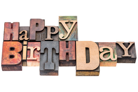 wood type: Happy Birthday sign or greeting card - isolated text in vintage mixed letterpress wood type Stock Photo