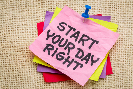Start your day right reminder - motivational handwriting on a sticky note against burlap canvas 免版税图像 - 41756403