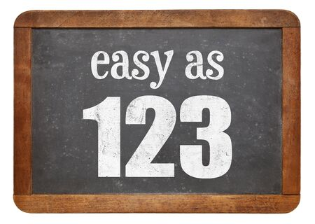 Easy as 123 sign - white chalk text  on a vintage slate blackboard Banco de Imagens