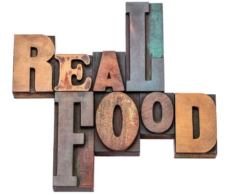 unprocessed: real food word abstract - isolated text in mixed letterpress wood type printing blocks - healthy eating and lifestyle concept