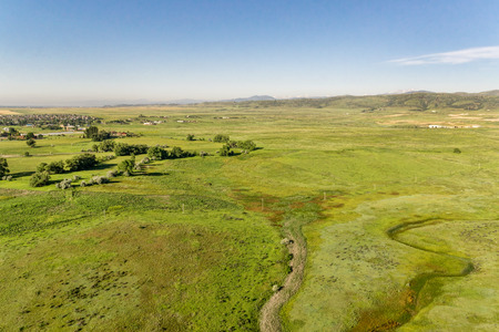 aerial view: aerial view of foothills prairie along Front Range of Rocky Mountains near Fort Collins, Colorado, early summer scenery Stock Photo