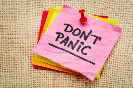 Do not panic on a sticky note against burlap canvas - dealing with stress concept