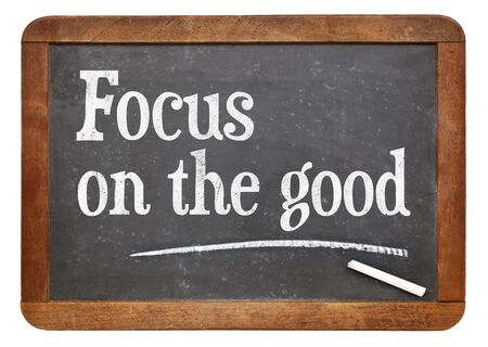 Focus on the good - positivity concept - text on a vintage slate blackboard