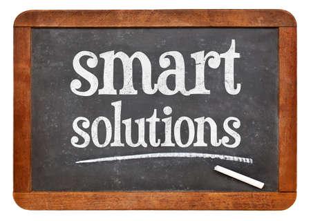 Smart solutions sign - white chalk text on a vintage slate blackboard Stock fotó