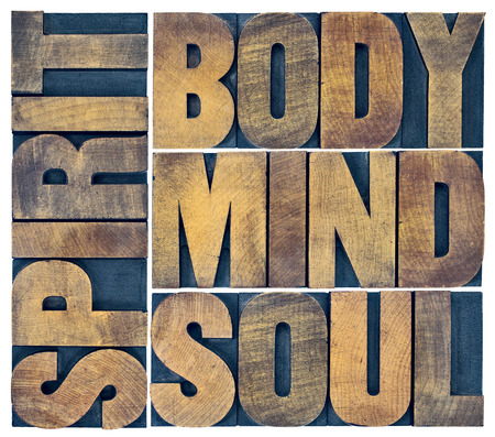 body, mind, soul and spirit word abstract - a collage of isolated text in vintage grunge wood letterpress printing blocks Stock Photo