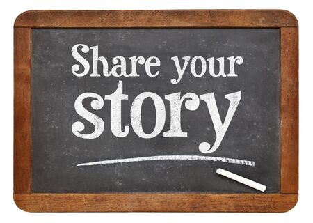 Share your story sign - white chalk text on a vintage slate blackboard