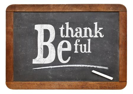 thankful: Be thankful blackboard sign - white chalk text  on a vintage slate blackboard Stock Photo