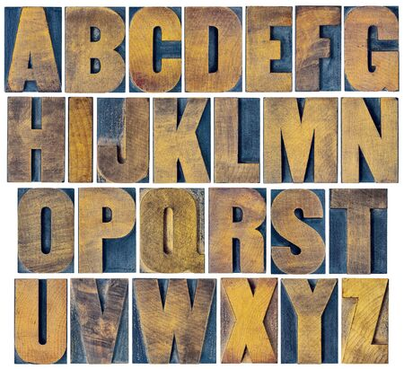 wood block: complete English alphabet - collage of 26 isolated vintage wood letterpress printing blocks, scratched and stained by ink patina