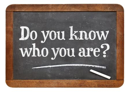 self awareness: Do you know who you are ? A question on a vintage slate blackboard