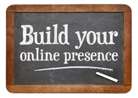 Build your online presence - internet marketing concept -  a text on a vintage slate blackboard
