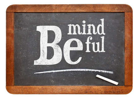motto: Be mindful sign - motto or resolution on a vintage slate blackboard