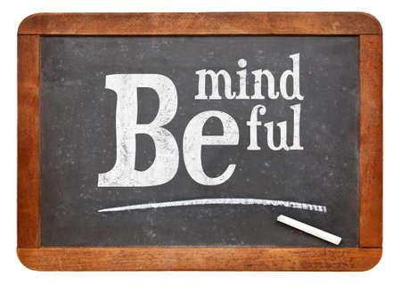 observant: Be mindful sign - motto or resolution on a vintage slate blackboard