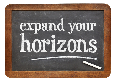expand: Expand your horizons - motivational text on a vintage slate blackboard