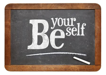 be the identity: Be yourself sign - motto or resolution on a vintage slate blackboard