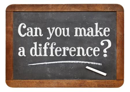 Can you make a difference question on a vintage slate blackboard Stock Photo