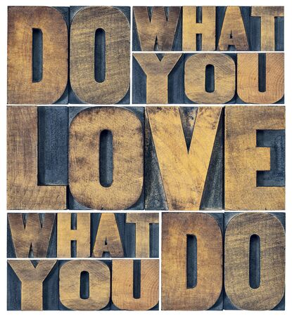 abstract love: do what you love, love what you do - motivational word abstract in grunge letterpress wood type printing blocks Stock Photo
