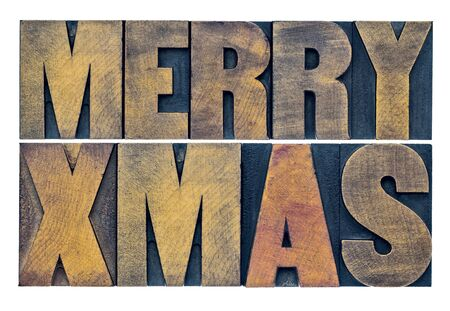 merry xmas: Merry Xmas (Christmas) greetings or wishes - isolated text in vintage grunge letterpress wood type blocks