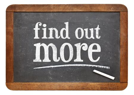 find out: Find out more sign - white chalk text  on a vintage slate blackboard Stock Photo