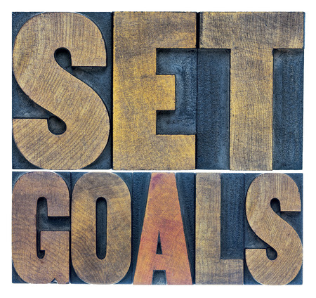 letterpress words: set goals typography abstract - a collage of isolated words in letterpress wood type