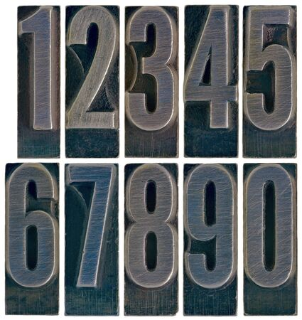 arabic numerals: ten arabic numerals 0 to 9 in old grunge metal letterpress printing blocks isolated on white Stock Photo