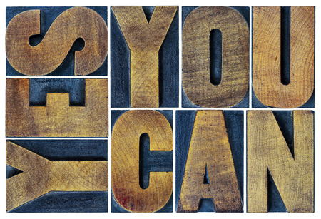 printing block block: Yes you can - motivational slogan - isolated text in vintage grunge letterpress wood type printing block, rectangular layout