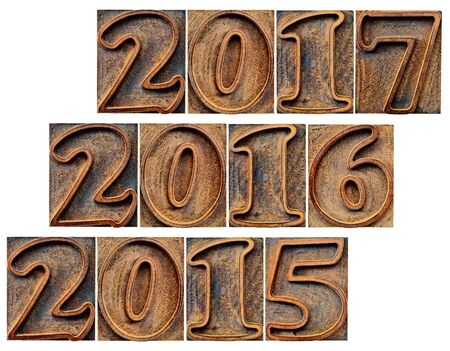 incoming: passing and incoming years (2015, 2016, 2017) in grunge letterpress wood type isolated on white