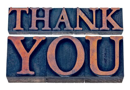 wood type: thank you  - isolated text in vintage letterpress wood type printing blocks stained by blue and orange inks